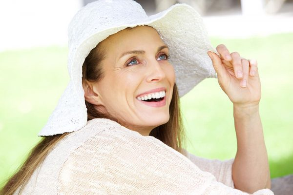 Woman smiling with hat